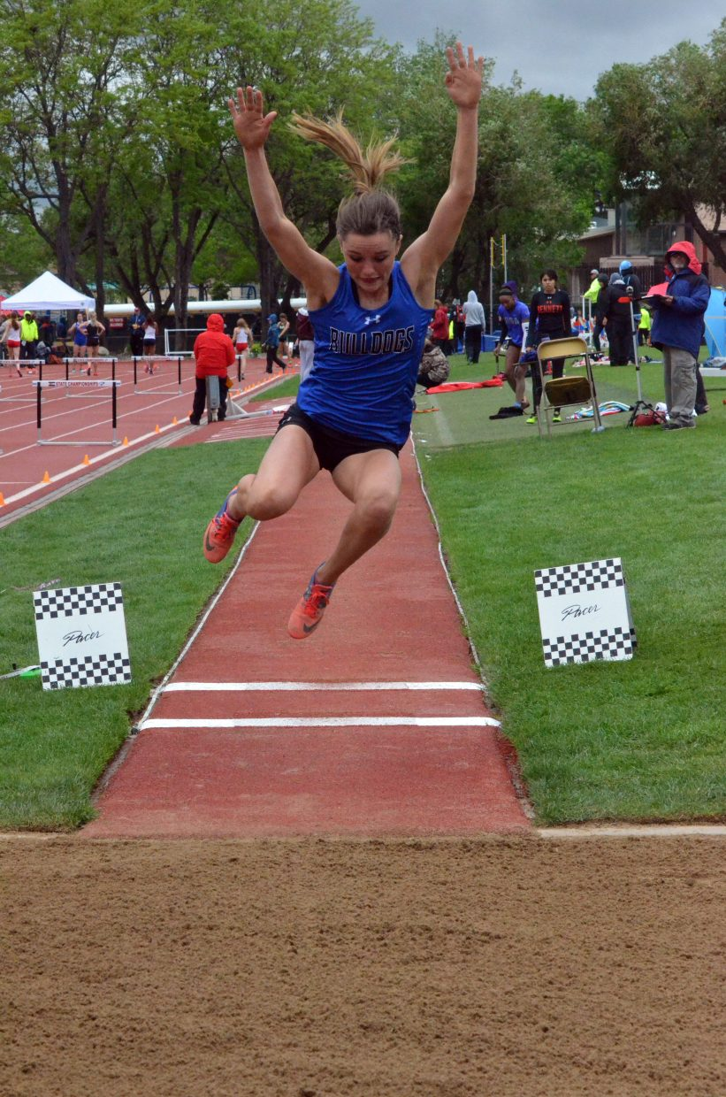 Moffat County High School's Stephenie Swindler takes her final leap in the long jump Saturday at the CHSAA State Championships.