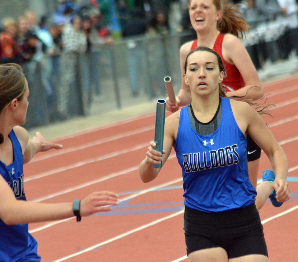 Moffat County High School's Quinn Pinnt reaches forward for the handoff in the 4x400-meter relay Saturday at the CHSAA State Championships.