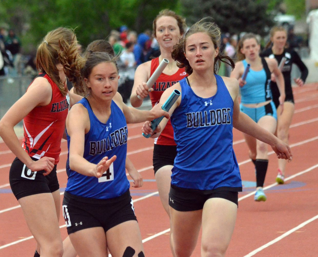 Moffat County High School's Emaleigh Papierski, left, grabs the baton from Josie Timmer for the final lap of the 4x400-meter relay Saturday at the CHSAA State Championships.
