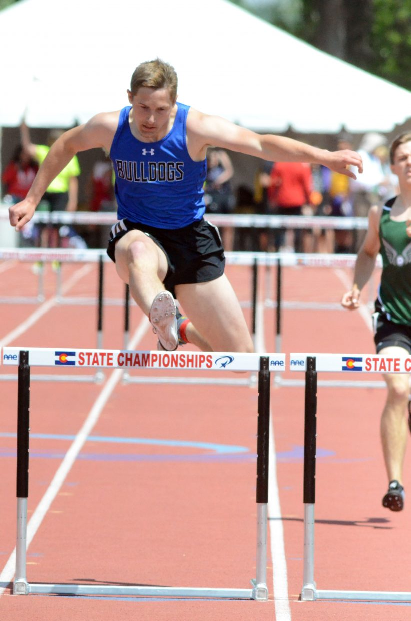 Moffat County High School's Miki Klimper takes his final hop before the finish line in the 300-meter hurdles preliminaries Friday at the CHSAA State Championships.