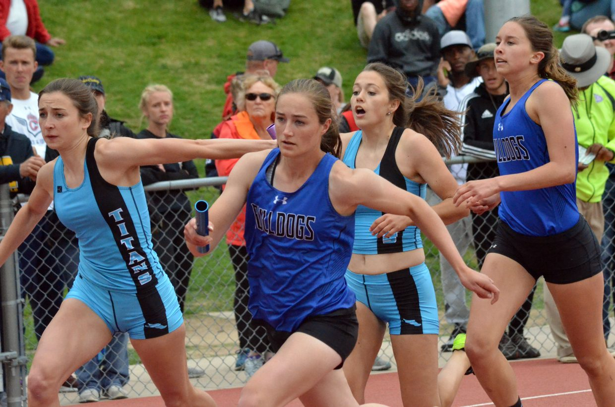 Moffat County High School's Josie Timmer looks to stay in front of Coal Ridge competition  after the handoff from Emaleigh Papierski in the 4x200-meter relay Friday at the CHSAA State Championships.