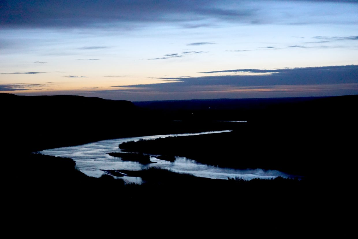 The Little Snake River glows in the dawn sun before the traditional Northern Ute prayer service, given at Sand Wash Basin in Moffat County on Sunday, May 6.