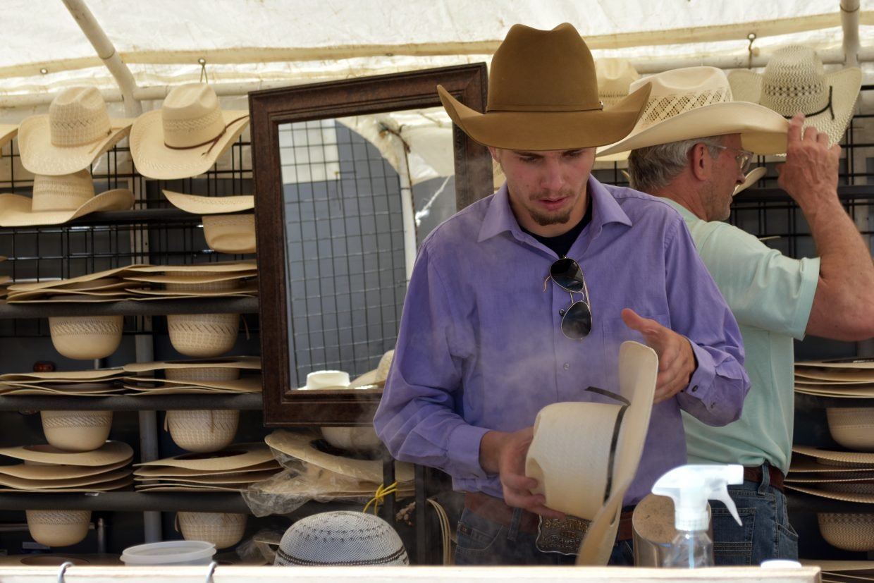 JC Mortensen shapes a cowboy hat at the Old West Festival Arts and Crafts Show in Craig on Saturday.