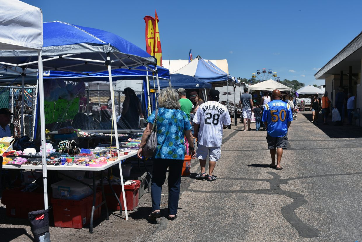 Visitors look over crafts and other items for sale at the Old West Festival Arts and Crafts Show in Craig on Saturday.