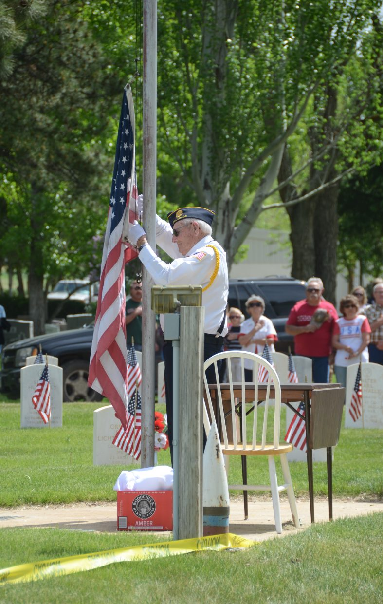 A member of the honor guard prepares to raise the American flag.
