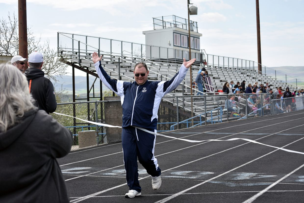 Jason Soos, of Craig, crosses the finish line at Special Olympics Colorado's Western Regional Competition on Saturday.