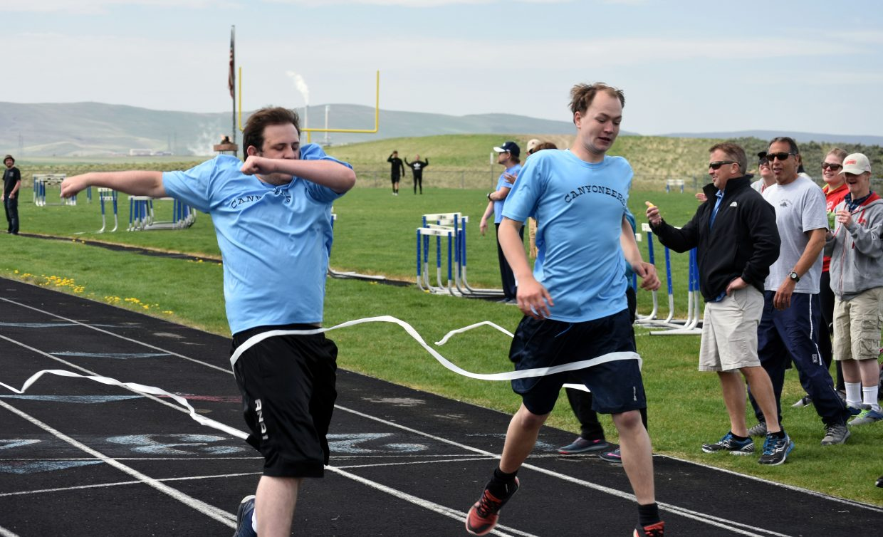 Nathaniel Weber, left, narrowly crossed the finish line before Zack Mckinnon during a race at Special Olympics Colorado's Western Regional Competition on Saturday. Weber and Mckinnon traveled from Montrose to compete in the event.