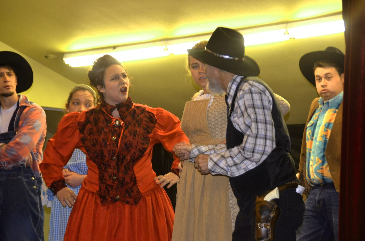 Prudence, left, played by Desiree Moore, has strong words for the sheriff, portrayed by Randy Looper, in Monday's performance of