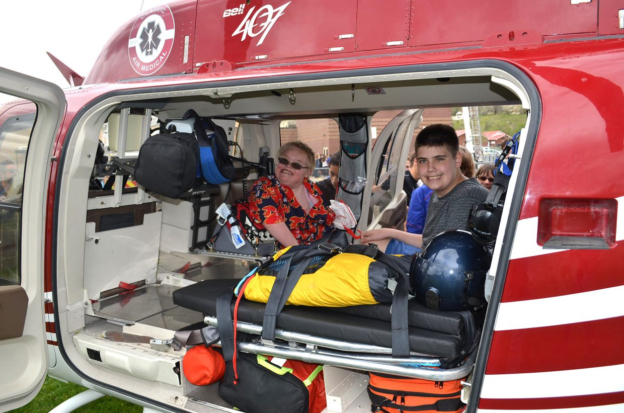 CMS students Clayton Ages, left, and Avery Chad take their turns sitting inside Classic Air Medical's helicopter during Trauma Day, held Friday, May 11, at CMS.