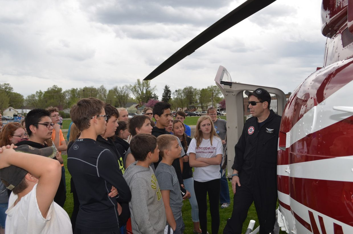 Anders Lowenfish, right, flight medic with Classic Air Medical, shows a group of Craig Middle School seventh-graders the Classic Air Medical helicopter as part of CMS Trauma Day on Friday, May 11. The full-day activity was organized to teach students emergency wound care, CPR, the Heimlich maneuver and wilderness survival techniques.