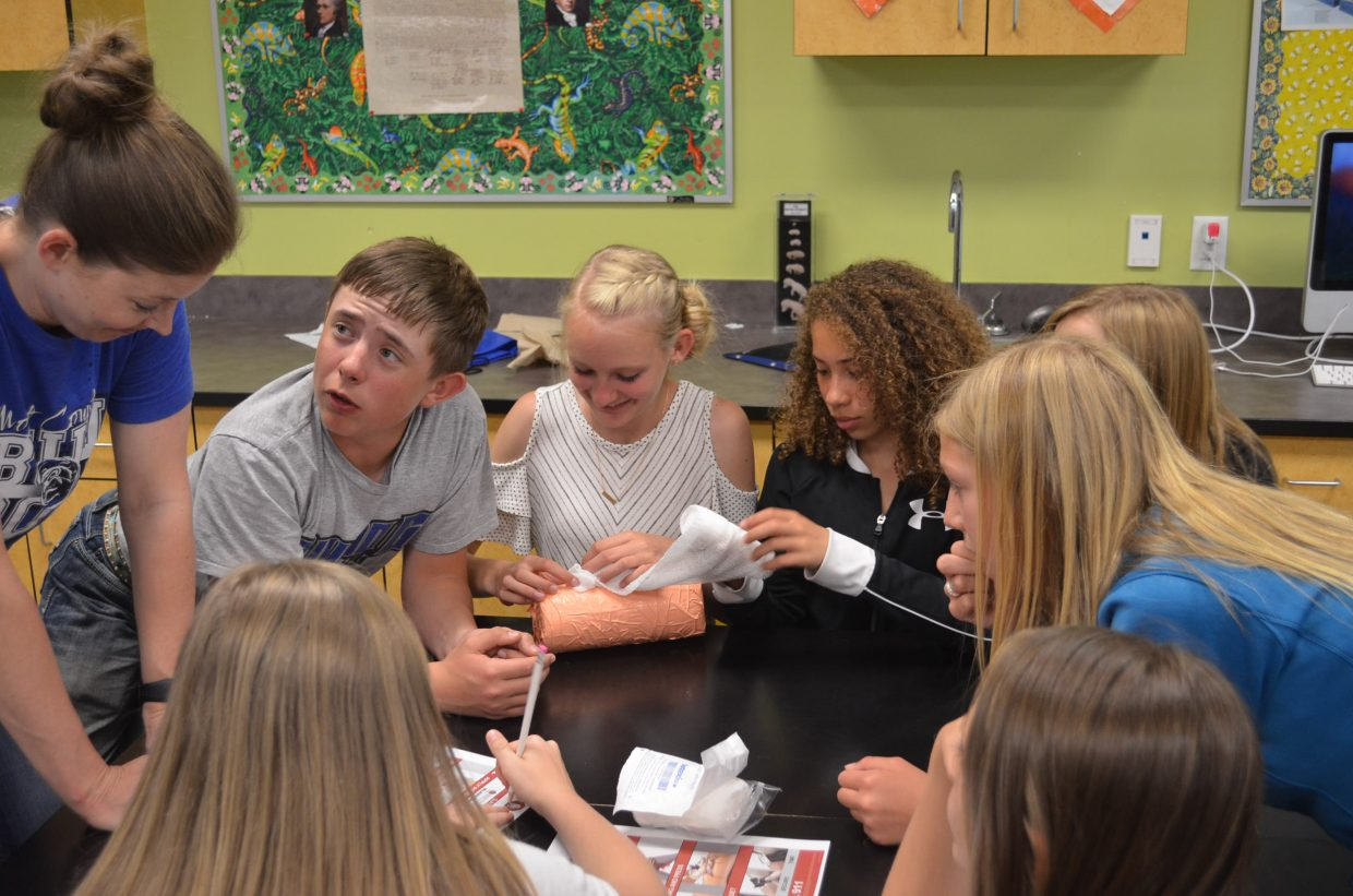 A group of CMS seventh-graders practice emergency techniques to stop bleeding during CMS Trauma Day, held Friday, May 11.