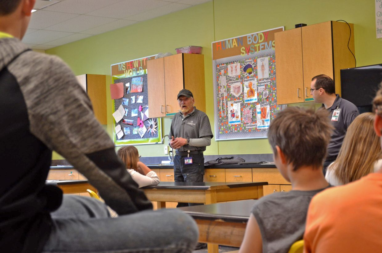 Michael Ferrara, Memorial Regional Health paramedic, talks with CMS seventh-graders about wilderness survival during Trauma Day, held Friday, May 11, at CMS.