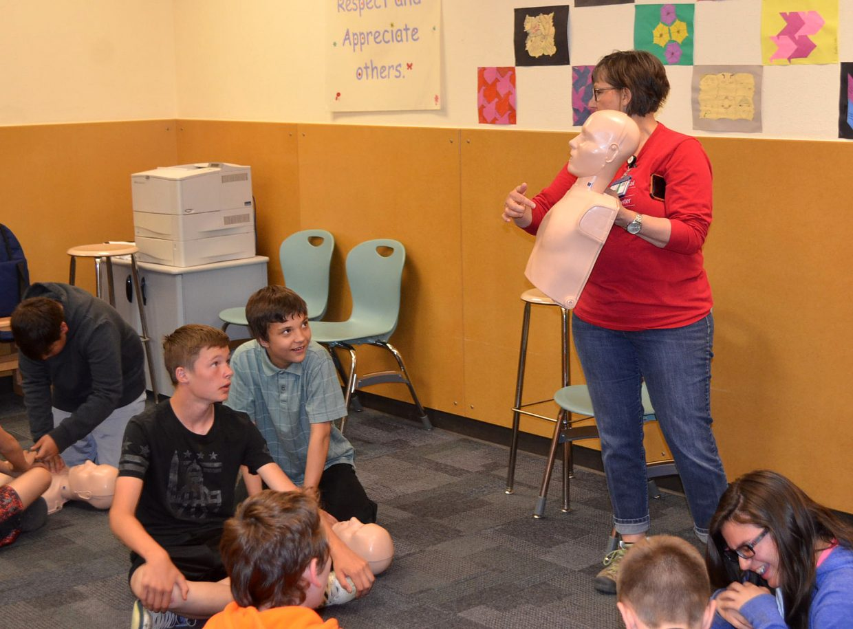 MRH nurse and clinical educator Kathy Fagan gives CMS seventh-graders instructions on performing CPR during CMS Trauma Day, held Friday, May 11, at CMS.
