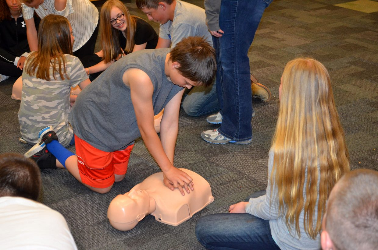 CMS seventh-grader Zachary Miller practices administering CPR during Trauma Day, held Friday, May 11, at CMS.