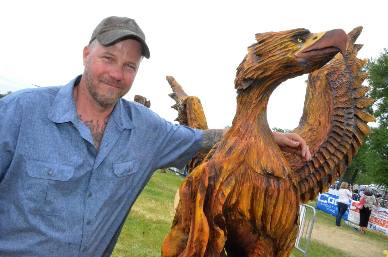 Joe Srholez of Gypsum displays his mythical carving