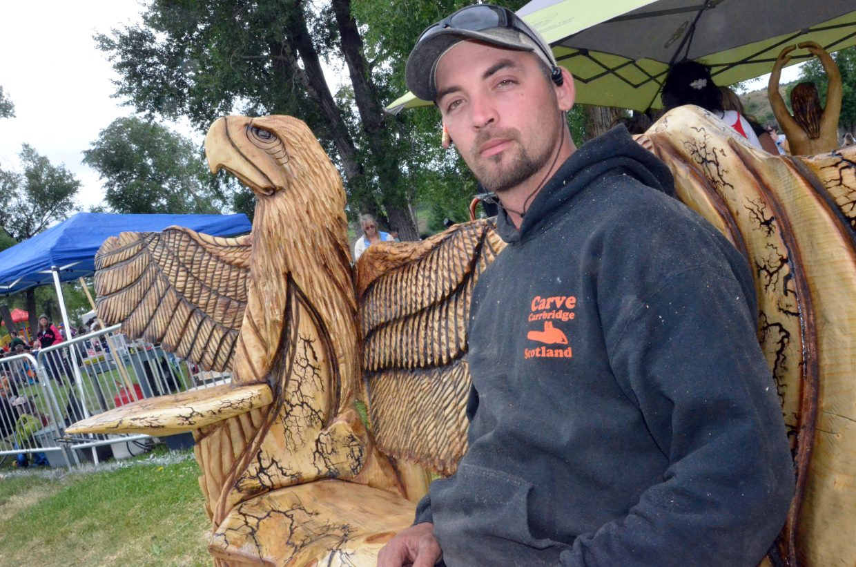 Damon Gorecki of Roosevelt, Utah, takes a load off on his freshly carved bench