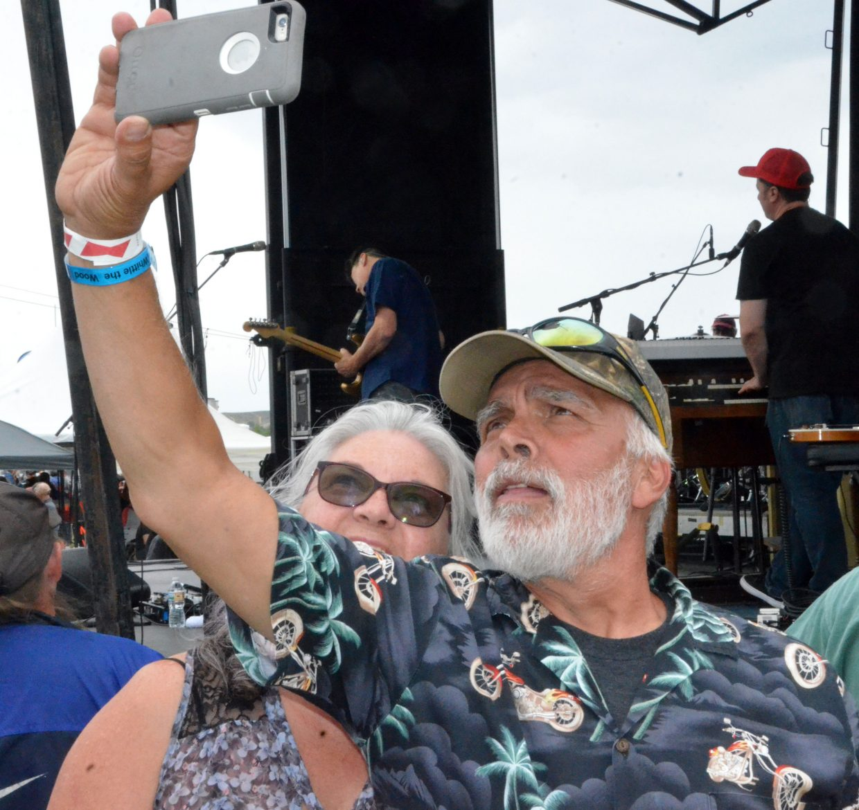 Rifle's Dino and Carmen Baldizan snap a selfie by the stage Saturday as Big Head Todd and the Monsters perform at the 19th annual Whittle the Wood Rendezvous.