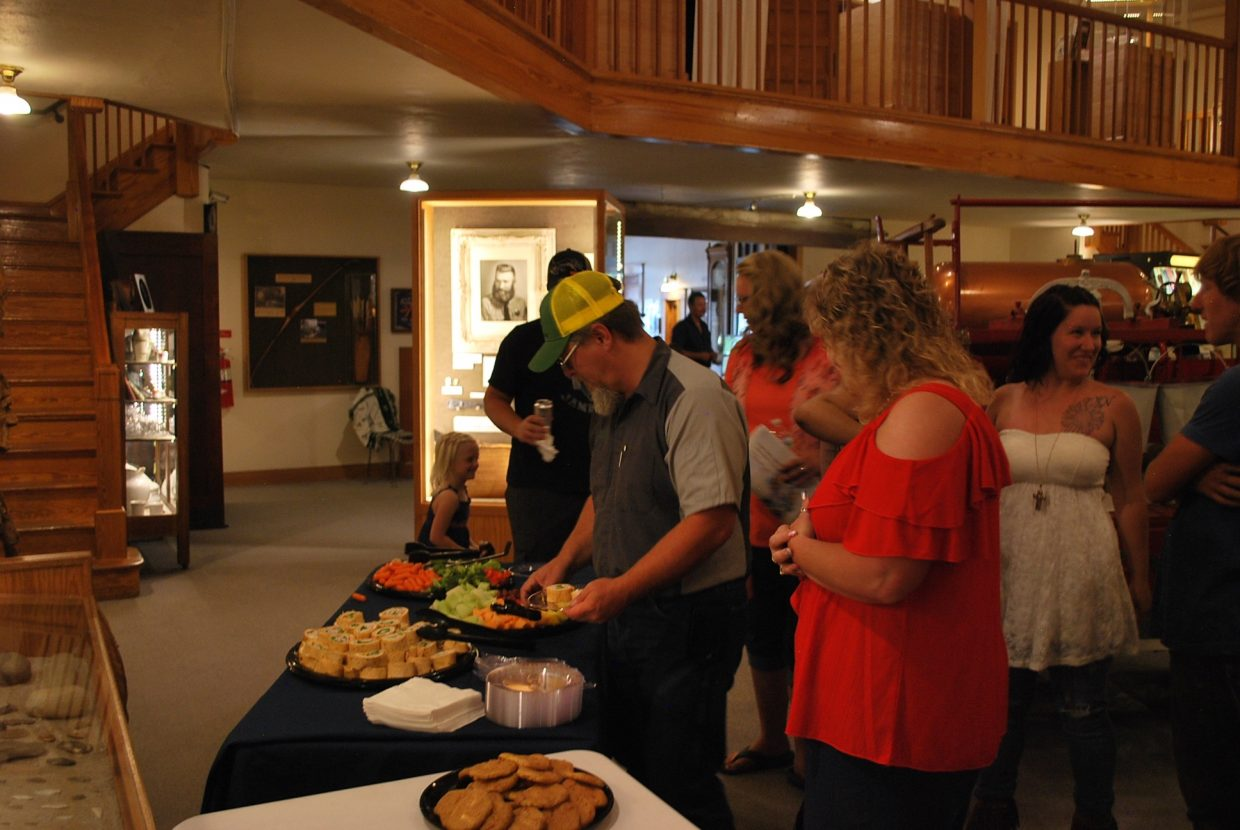 Residents helped themselves to snacks as they waited on the announcement of first place winners.