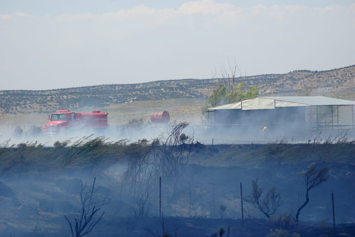 North, northeastern winds pushed a small wildfire toward homes and barns. All the structures were saved.