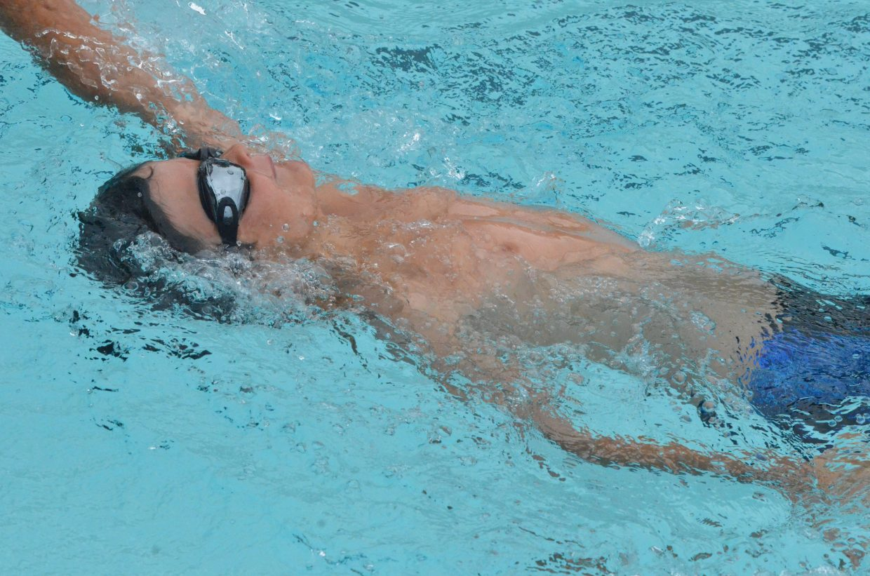 Christian Ausmus competes in the 50 backstroke during Craig Sea Sharks Open Swim Meet Saturday at Craig Pool Complex.