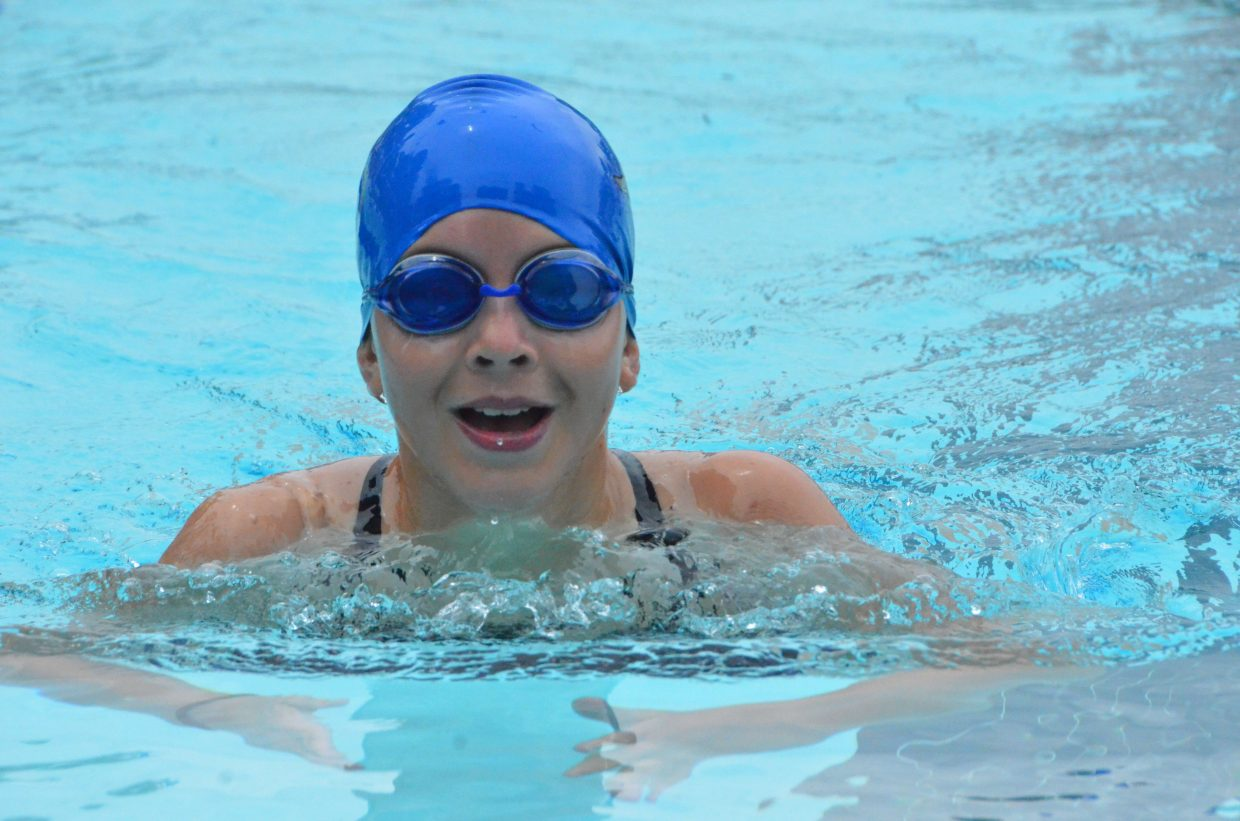 Emma Fritz can't help but smile amid the 200 breaststroke during Craig Sea Sharks Open Swim Meet Saturday at Craig Pool Complex.