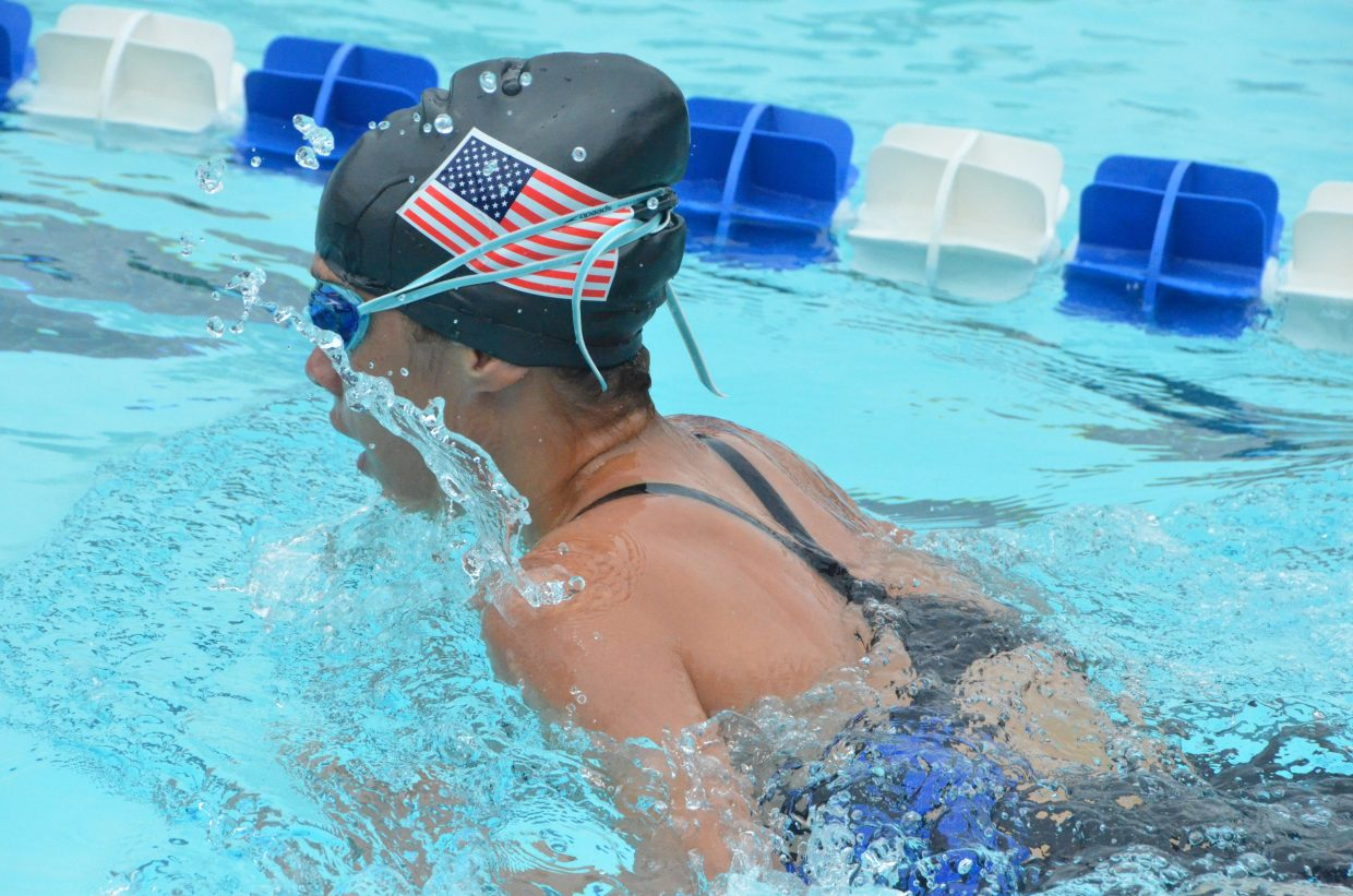 Sarah Johnson competes in the 200 medley relay during Craig Sea Sharks Open Swim Meet Saturday at Craig Pool Complex.