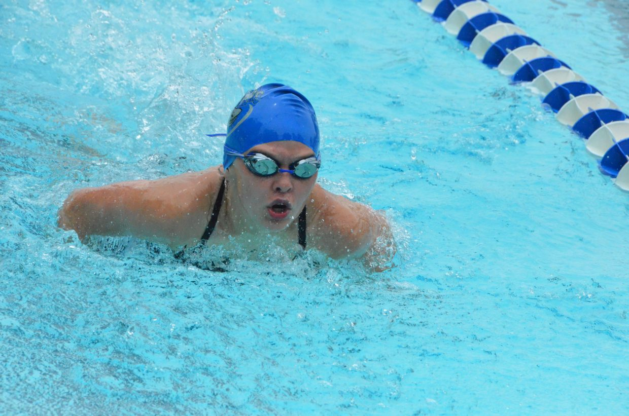 Megan Neton competes in the 200 medley relay during Craig Sea Sharks Open Swim Meet Saturday at Craig Pool Complex.