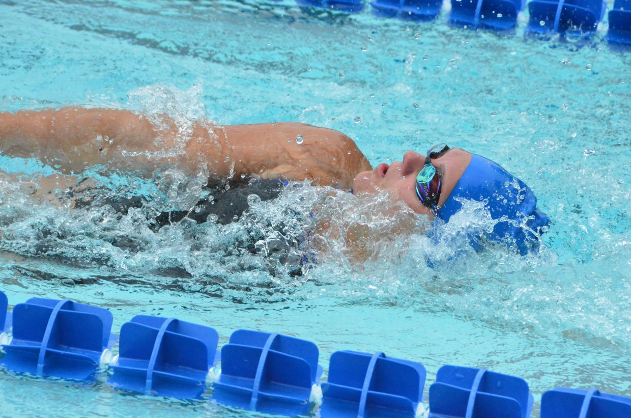 Katelynn Turner preps for a turn in the 200 medley relay during Craig Sea Sharks Open Swim Meet Saturday at Craig Pool Complex.