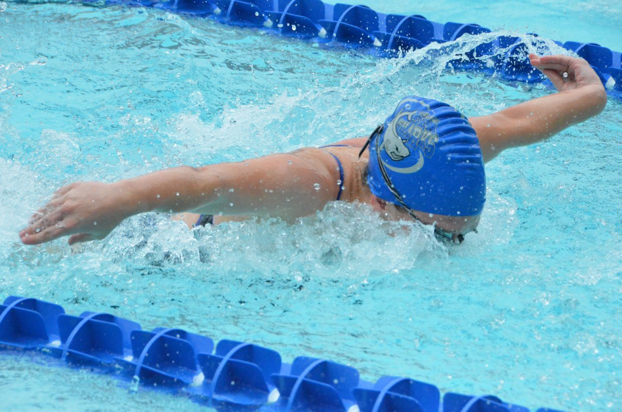 Molly Neton swims the butterfly stroke in the 200 medley relay during Craig Sea Sharks Open Swim Meet Saturday at Craig Pool Complex.