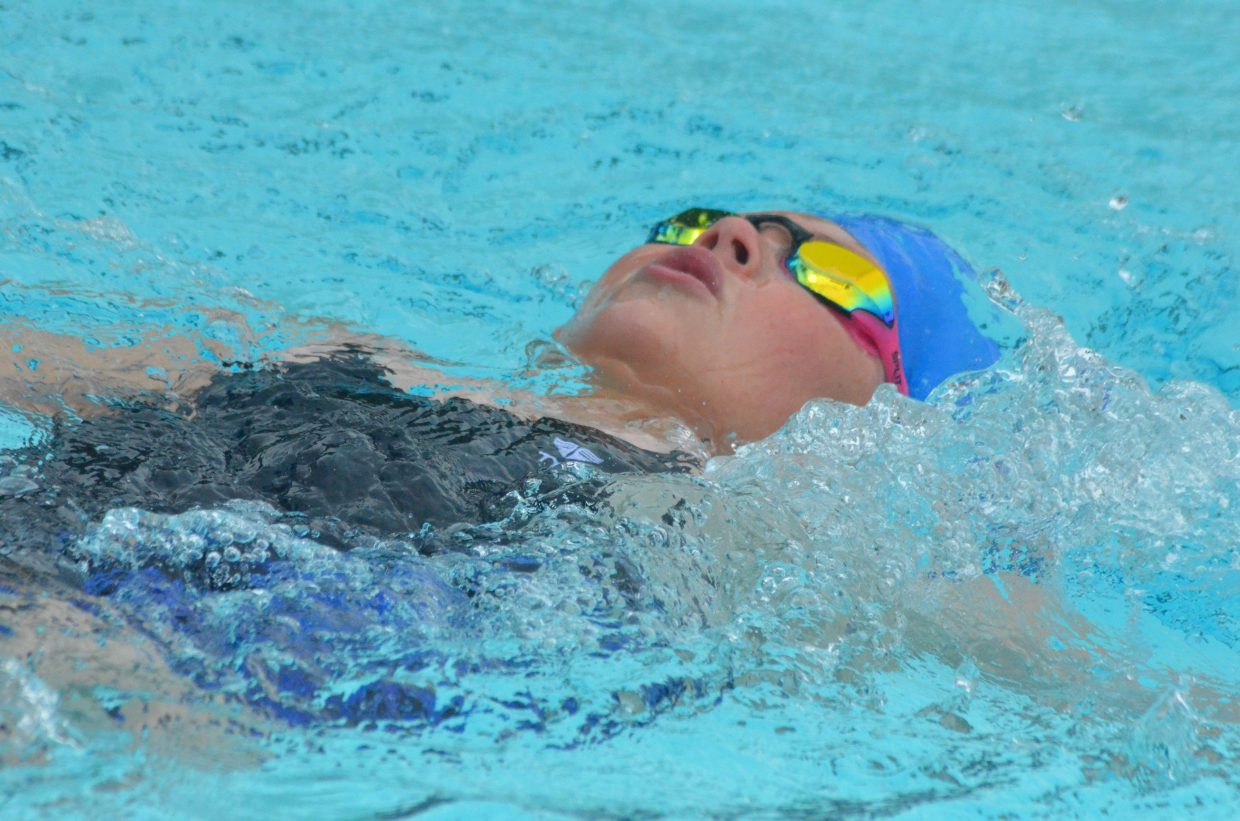 Kennedy Kostur swims the backstroke in the 200 medley relay during Craig Sea Sharks Open Swim Meet Saturday at Craig Pool Complex.
