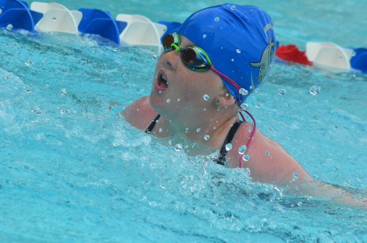 Peyton Ely competes in the 200 medley relay during Craig Sea Sharks Open Swim Meet Saturday at Craig Pool Complex.