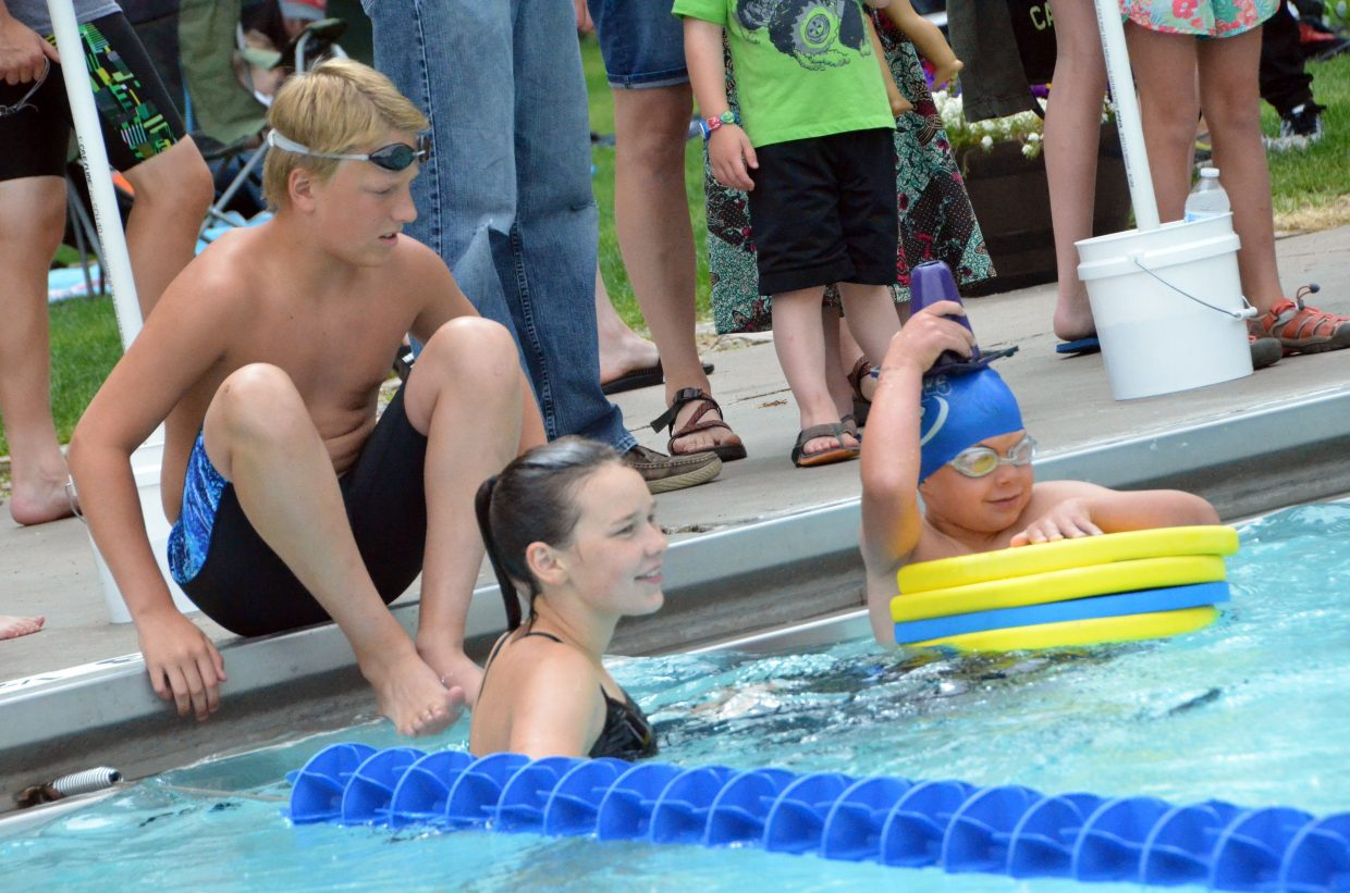 Craig Sea Sharks compete in the paddleboard relay between rounds of their home event Saturday at Craig Pool Complex.