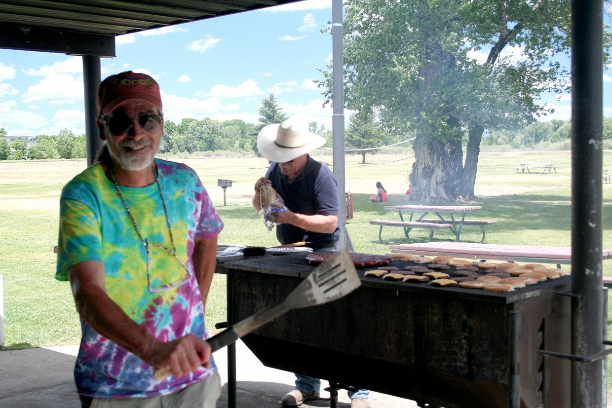 David Morris and other members of the Northwest Colorado Chapter of the Parrotheads provide lunch at Loudy-Simpson Park for volunteers and guests of the YVLSP