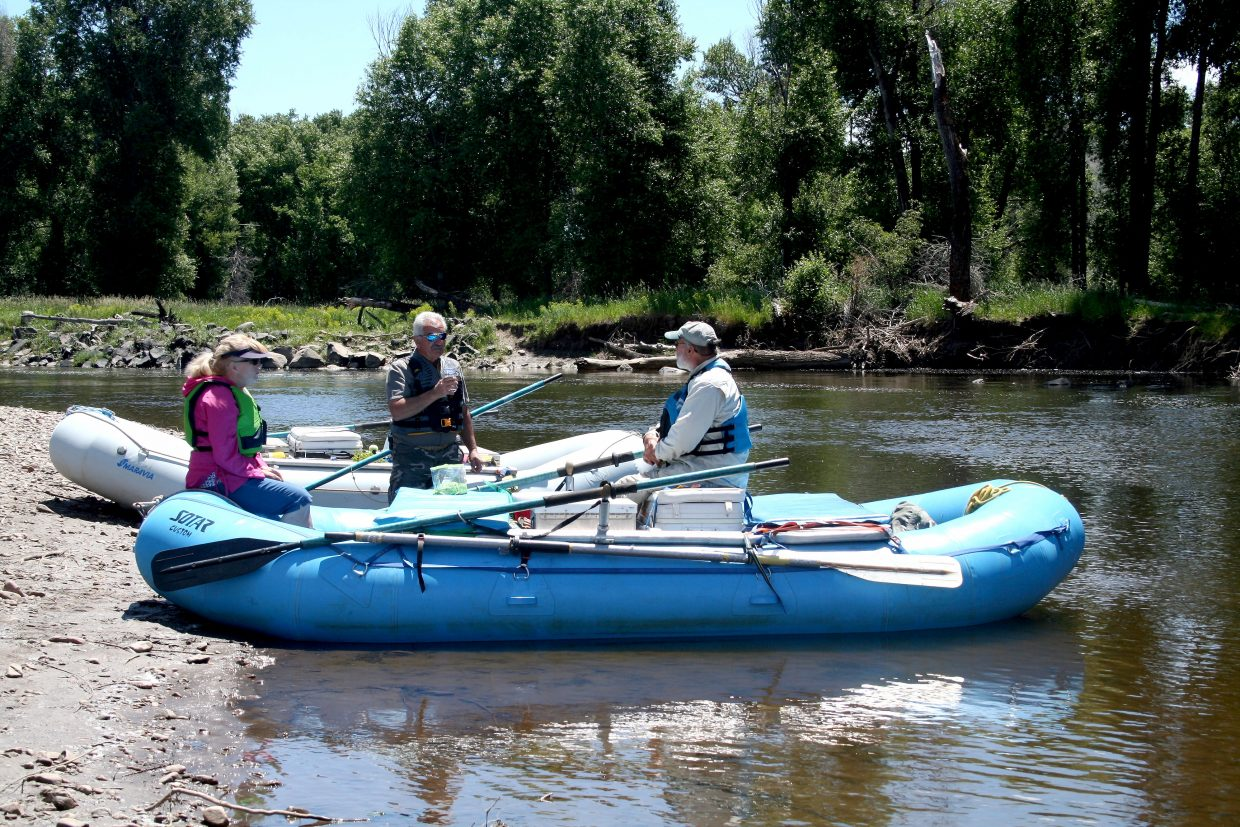Nick and Ann Charchalis are landowners and members of the Moffat County Weed Board. Here, they board Yampa River Leafy Spurge Project partner Ben Beall's raft to float a 10-mile stretch of the river east of Craig.