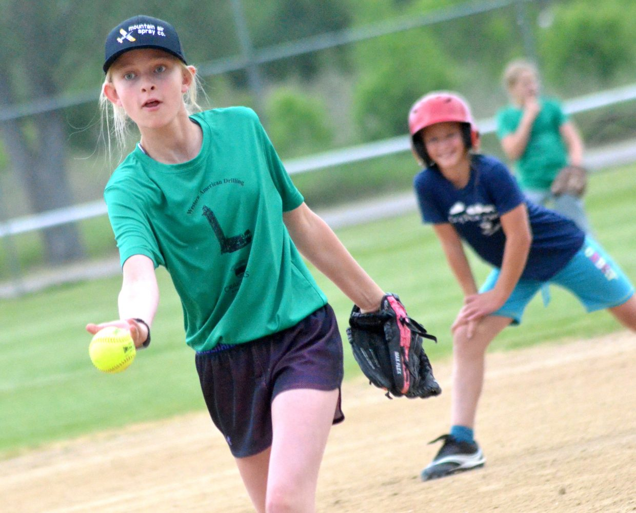 Emma Tucker lets loose a pitch during a Tuesday game between Western American Drilling and Craig Family Dental.