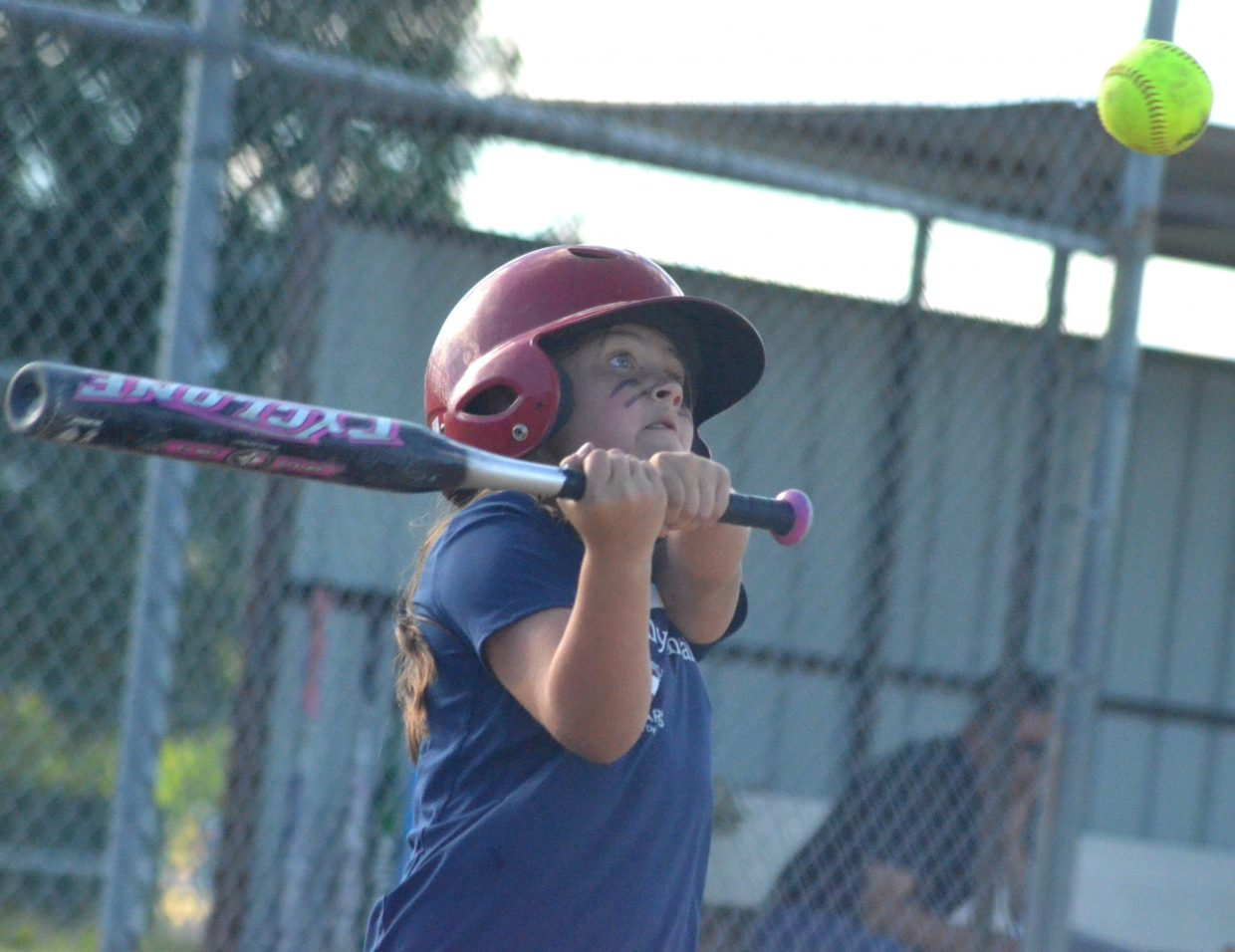 Craig Family Dental's Kennedy Kostur swings at a high pitch.
