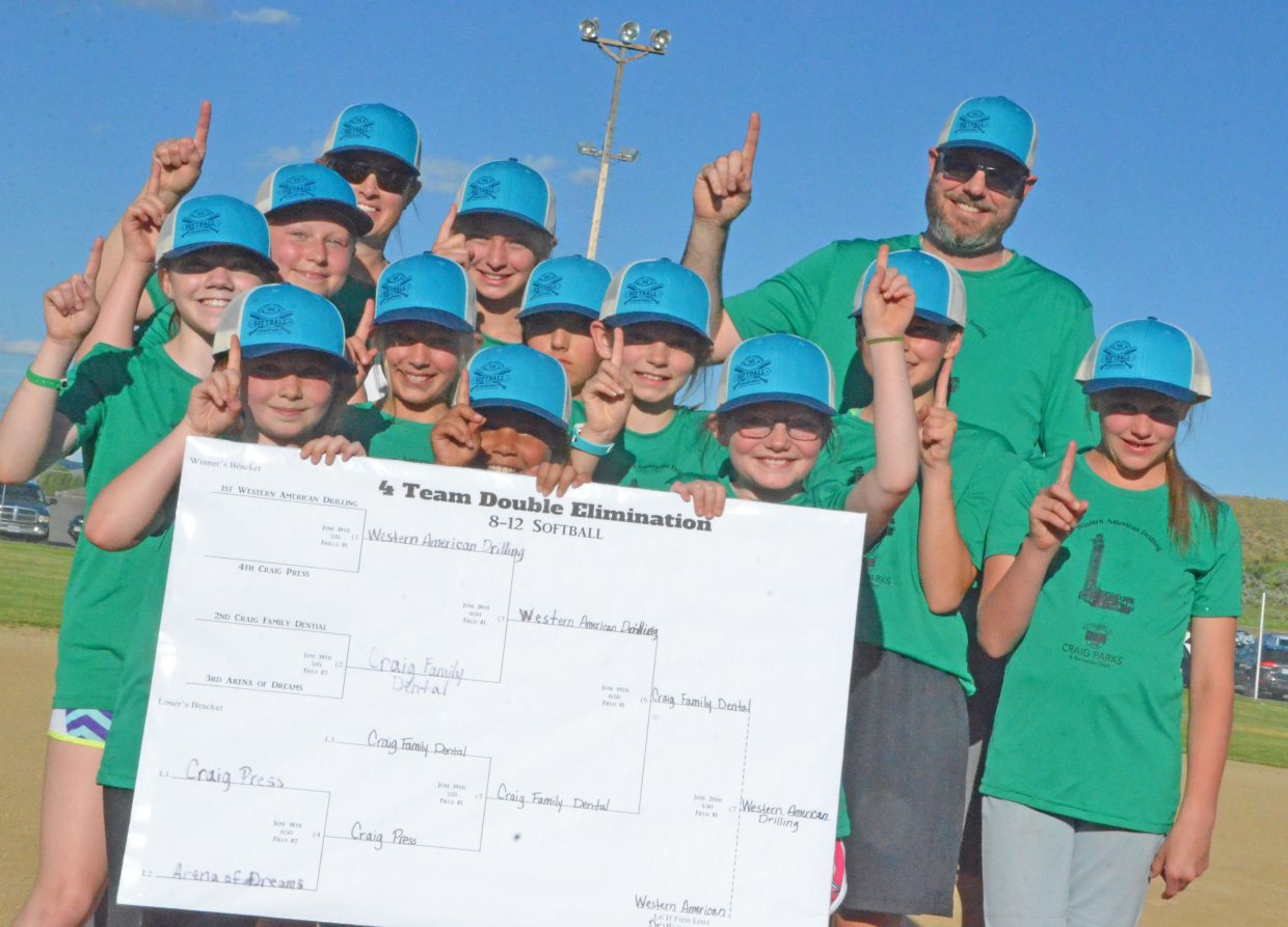 The players and coaches of Western American Drilling flash the No. 1 sign as the champions for the Craig Parks and Recreation 8- to 12-year-old softball league Wednesday at Loudy-Simpson Park. The team defeated Craig Family Dental 12-7 for the title.
