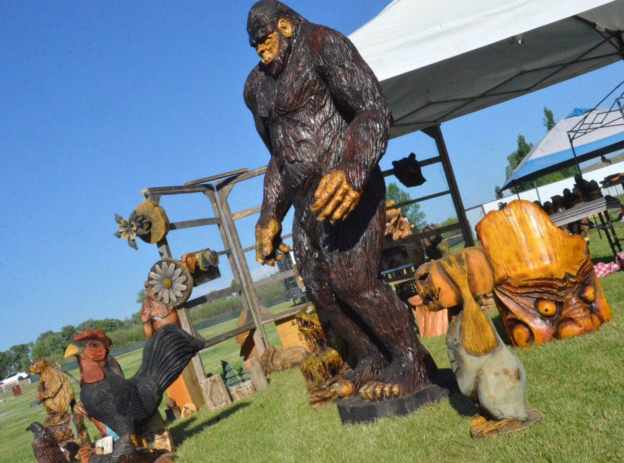 An eight-foot tall Sasquatch looms over a variety of wood carvings for sale at the 19th annual Whittle the Wood Rendezvous.