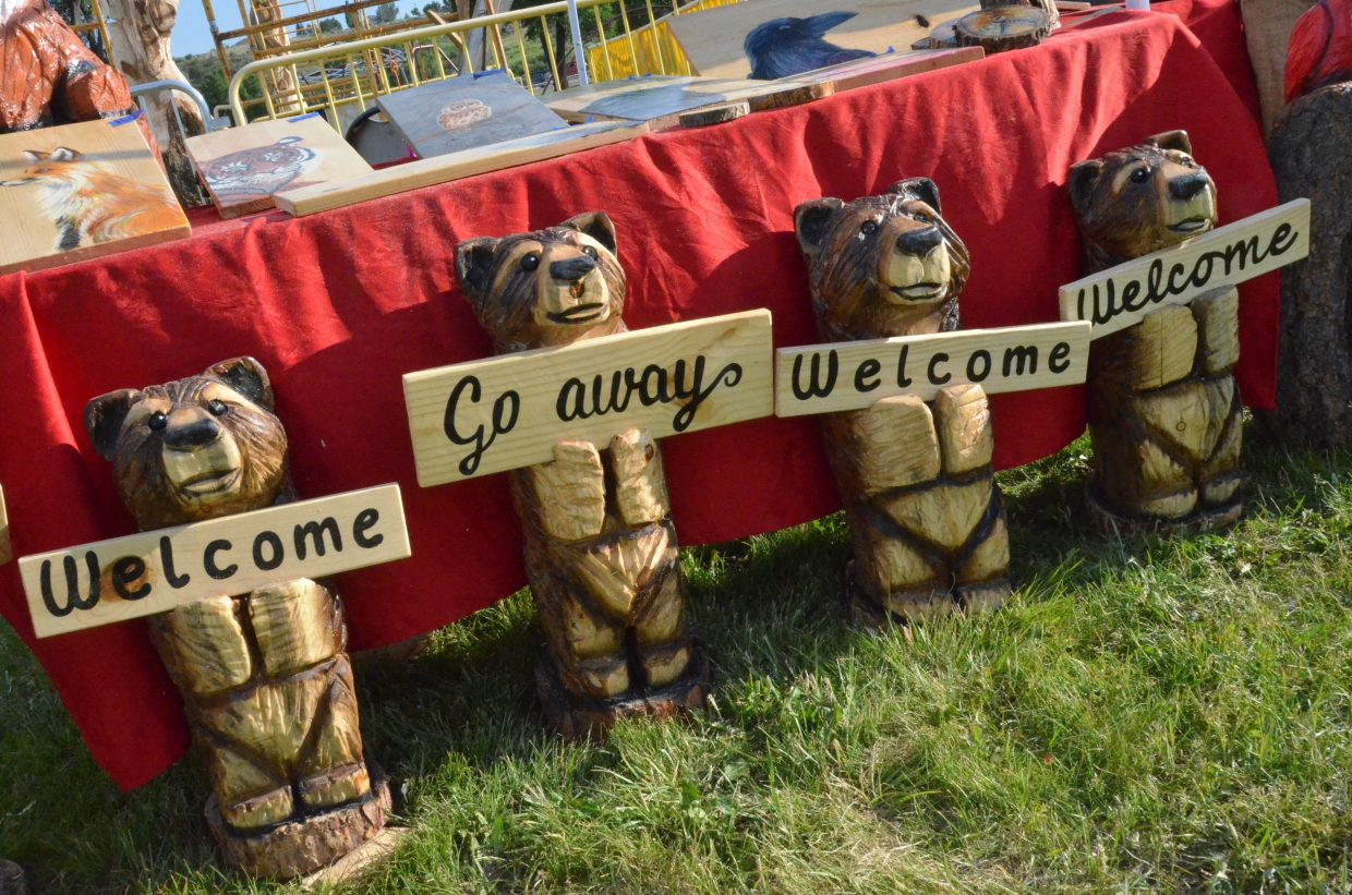 Wooden bears offer contrasting messages during the 19th annual Whittle the Wood Rendezvous at Loudy-Simpson Park.