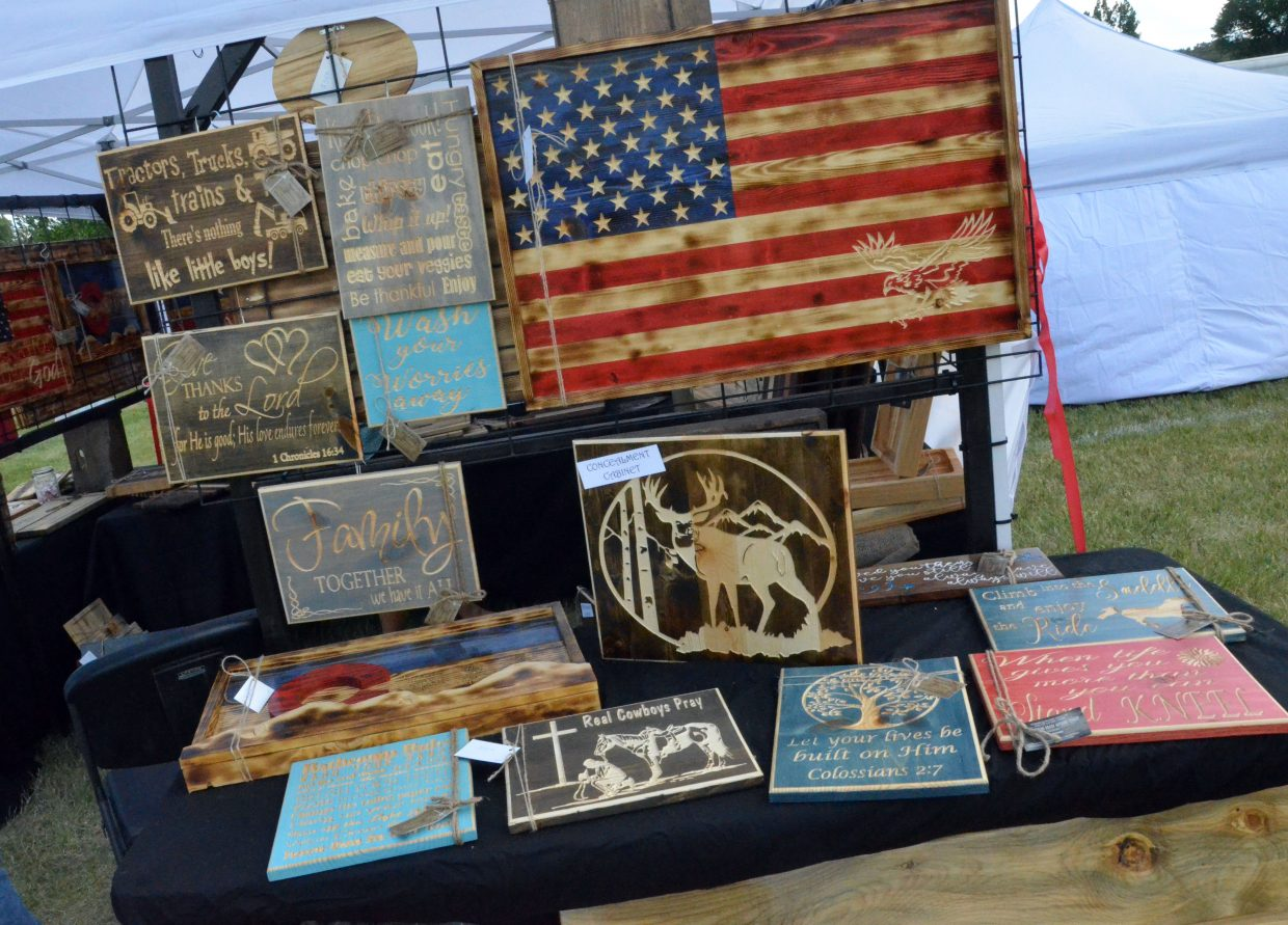 A variety of wood signs are among the crafts for sale during the 19th annual Whittle the Wood Rendezvous at Loudy-Simpson Park.