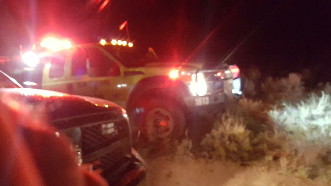 BLM wildlands firefighters responding to a small brush fire in Sand Wash Basin after dark Saturday, July 7.