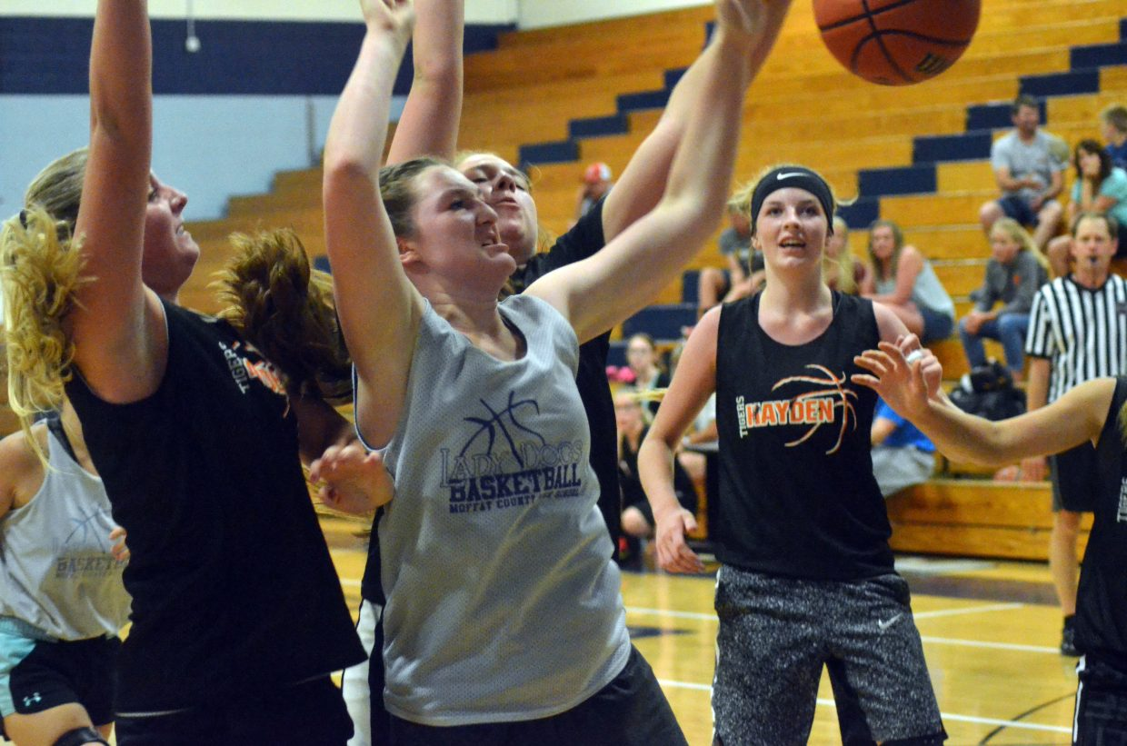 Moffat County High School's Tiffany Hildebrandt mixes it up with Hayden opponents beneath the Bulldog basket.