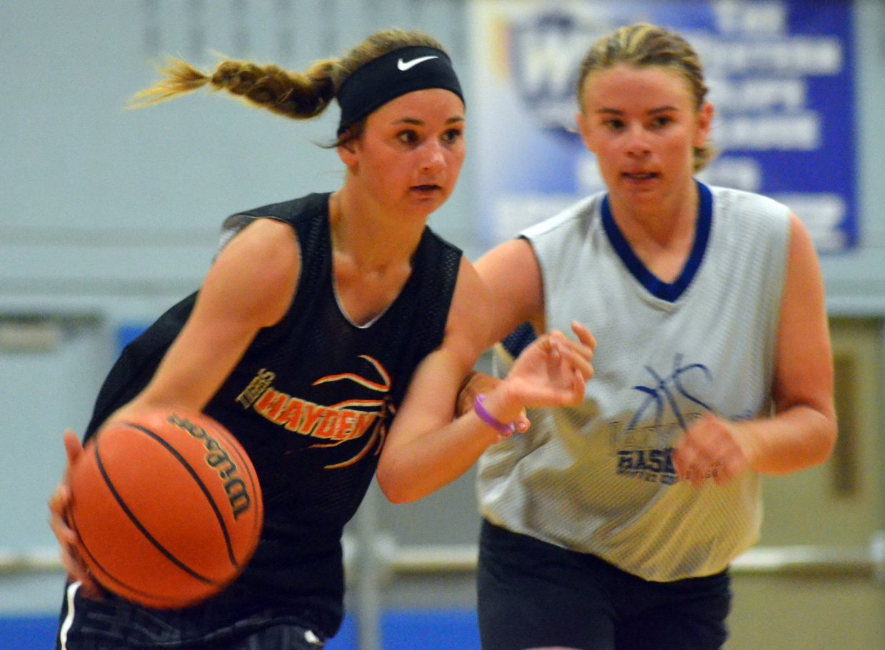 Hayden's Gracie Day drives to the hoop while guarded by Moffat County's Brittnee Meats.