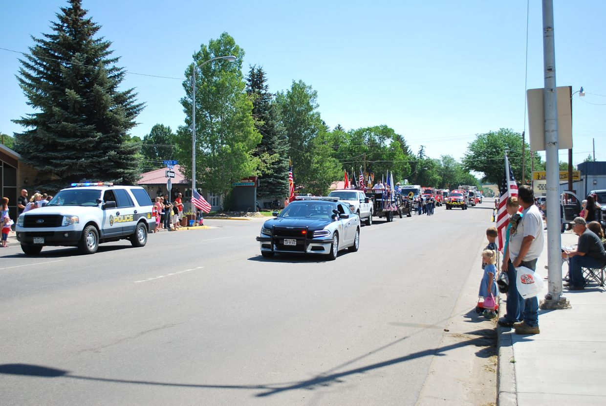 Law enforcers lead the parade as the parade down Victory Way.