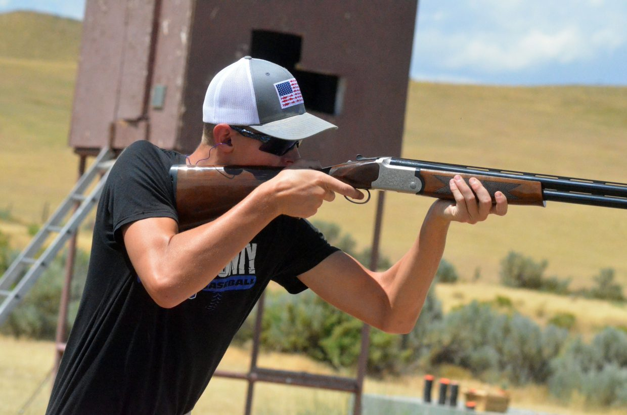 Kameron Baker stays ready for another round on the skeet course during the shotgun state completion shoot at Craig Trap Club.
