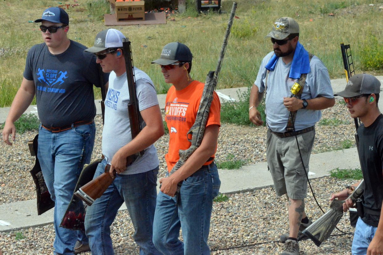 From left, Jesse Earle, Toryn Hume, Colby Beckett, coach Jason Blackwell and Carlin King head off the range after a successful round of trap shooting during the shotgun state completion shoot at Craig Trap Club.