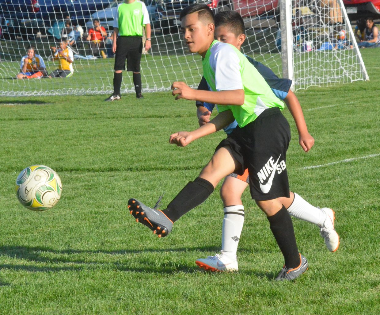 Edgar Hernandez, of the Voltage, kicks a lengthy pass downfield during a Craig Parks and Recreation 12 and under soccer game.