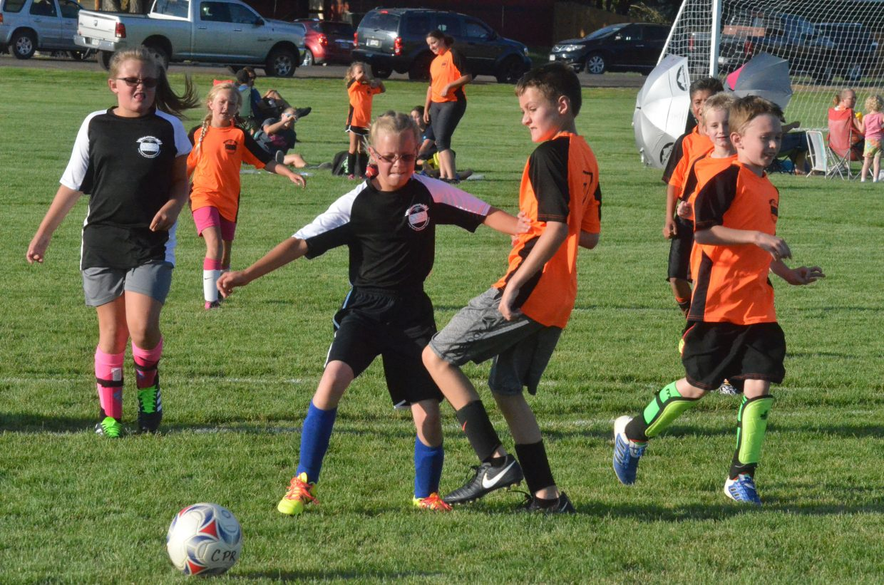 The Knights and the Monarchs face off at midfield during a Craig Parks and Recreation 10 and under soccer game.