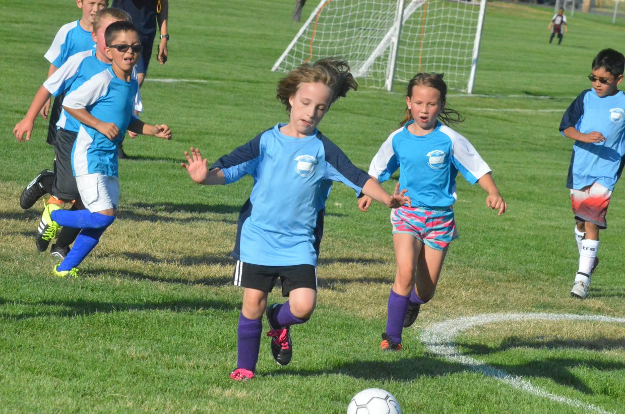 The Rapids' Sidney Moyir, left, and the Galaxy's Riley McCain pursue the ball during a Craig Parks and Recreation 8 and under soccer game.