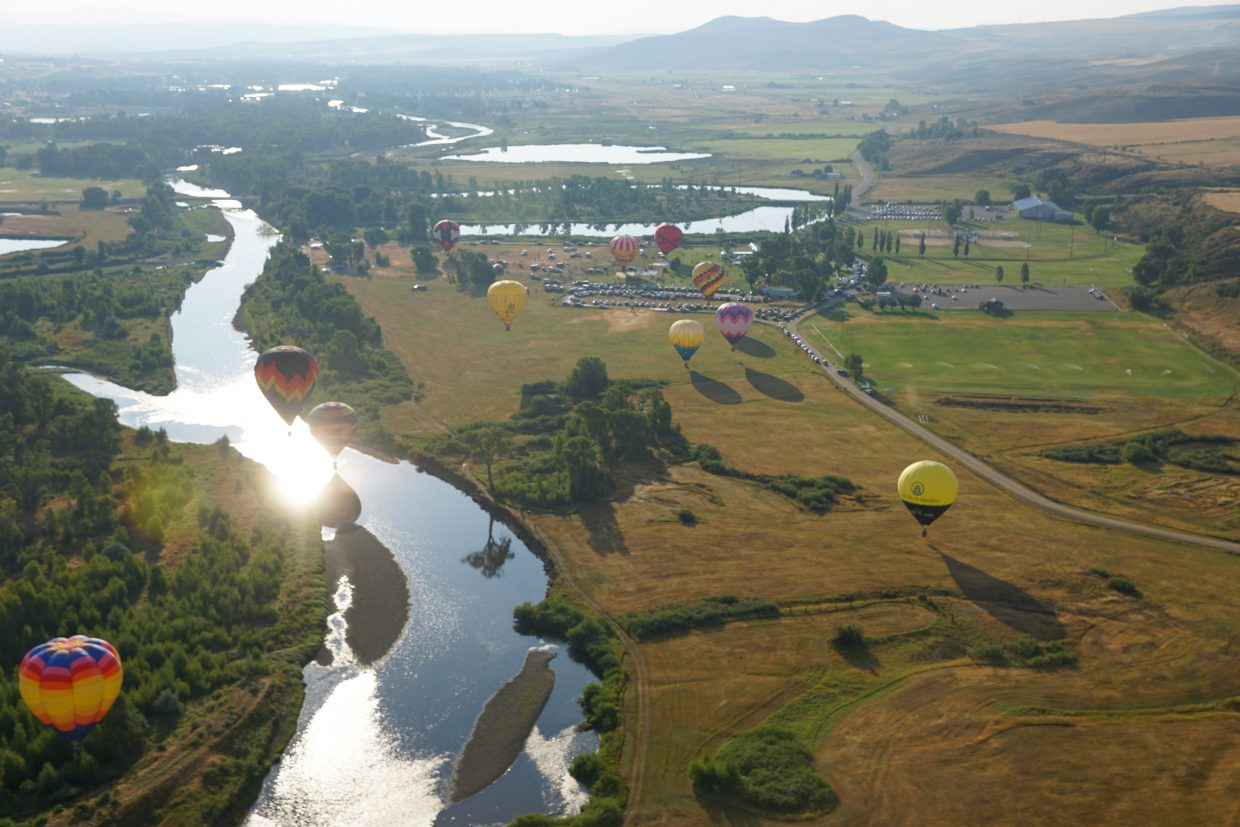 Hot air balloons drift over Loudy-Simpson Park and the Yampa River south of Craig.